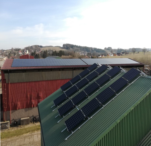 Local farm animals are happy to use the green power generated by the new 156 kWp solar power plant.